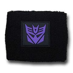 Transformers Decepticon Symbol Wristband - These Deceptacon wristbands are exactly what meets the eye. They'll help you out when the heat is on and let others know that you're not going to transform into anyone's joyride anytime soon.Materials: 75% Cotton, 10% Nylon, 15% SpandexFeaturing a stitched, rubber, Decepticon symbol. One size fits most.Colour: Black and Purple.