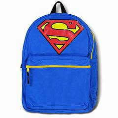 Superman Backpack: Caped & Belted - Who wouldn't want this for yourself or someone else you know? The Superman Caped & Belted Backpack is made from 100% polyester and measures approximately 40cm in height.  It features a cape (stored in a small compartment at the top of the back pack) and two straps that go across the wearer's front: one with the superman symbol across the chest, and one with a yellow circle across the waist. How fun is that?