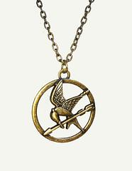 Hunger Games Necklace Mockingjay - Forged in the antique metal style and with its charm measuring 4cm in diameter, this film-faithful The Hunger Games Single Chain Mockingjay Necklace looks amazing and is the perfect mix of delicate and tough, just like a certain girl we all know from District 12.