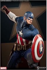 Captain America Premium Format Statue - The First Avenger is looking as heroic as ever in this Premium Format statue. A perfect mixture of the Comic book cap' we all love and the realistic portrayal by Chris Evens. This statue stands at 22 inches tall dressed in his classic USO tailored fabric uniform with sculpted armor details, authentic military belt including storage pouches, a holstered knife, side arms and an entrenching shovel with scabbard. Cap' also comes with two of his iconic shields, his classic triangular...